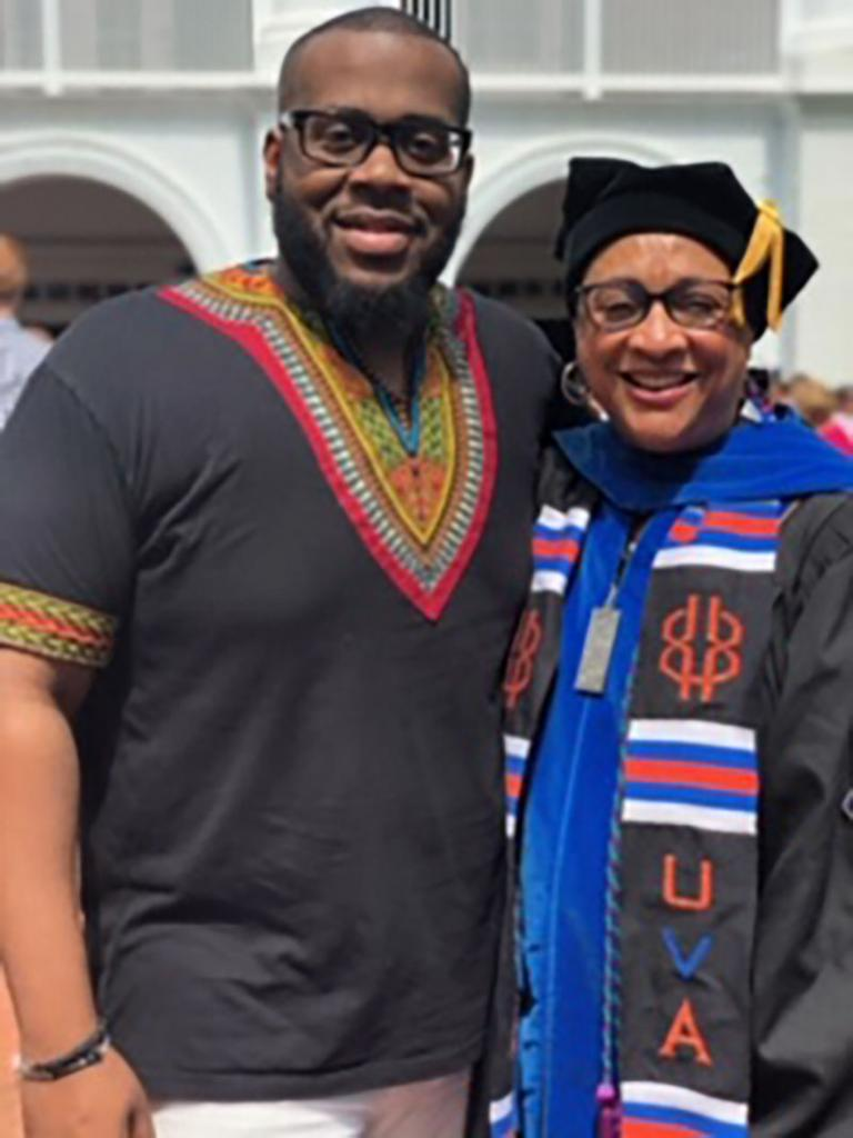 Jeffrey Smith & Grimes at 2019 Curry School doctoral hooding (his wife, Danielle got her PhD)